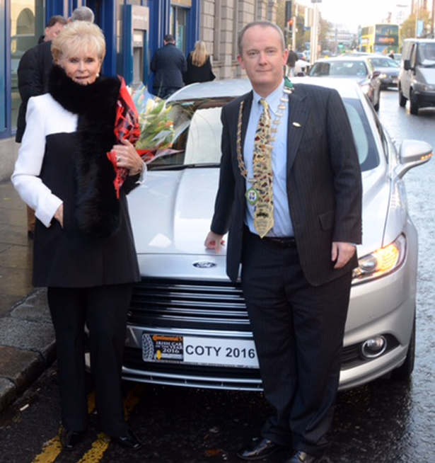 Motorsport legend Rosemary Smith is pictured with John Galvin, Chairman of the Irish Motoring Writers' Association and the Ford Mondeo, Continental Irish Car of the Year 2016